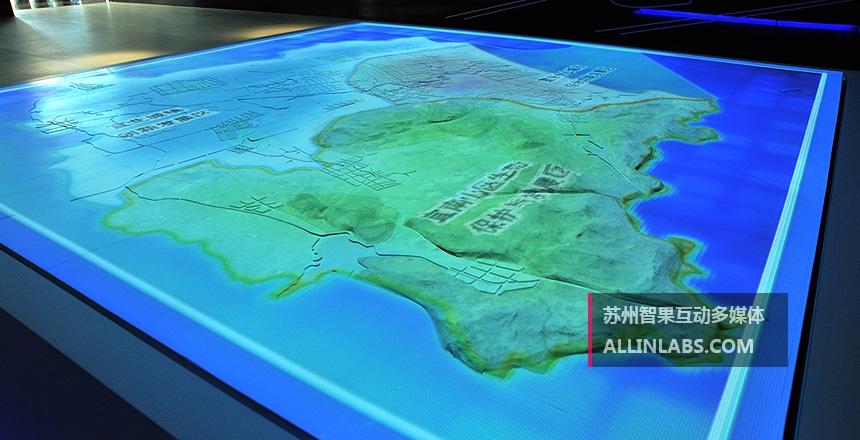 图像投影在素模沙盘上,可以用来表现城市或者园区的发展情况,交通分布